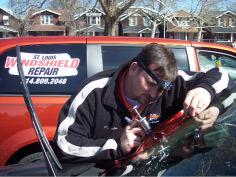 worker repairing damaged windshield